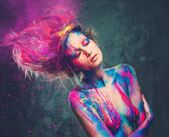 Young woman muse with creative body art and hairdo — Stock Photo