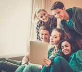 Group of young friends taking selfie in home interior  — Stok fotoğraf