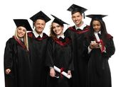 Multi ethnic group of graduated young students isolated on white — Стоковое фото