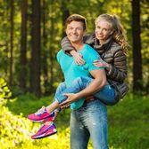 Happy teenage couple having fun outdoors on sunny day — Stockfoto