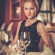Young beautiful girl alone in a luxury restaurant — Stock Photo