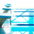 Starting blocks and lanes in a swimming pool — Stock Photo #47358035