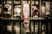 Storage room in firefighting depot with water hoses  — Stock Photo