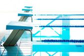 Starting blocks and lanes in a swimming pool  — Stock Photo