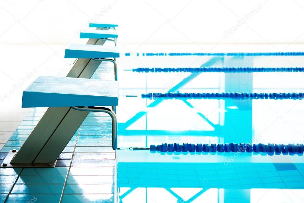 Starting Blocks And Lanes In A Swimming Pool Stock Photo