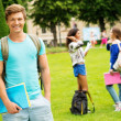 Handsome man student in a city park on summer day — Stock Photo #47742557