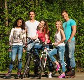 Multi ethnic group of sporty teenage friends in a park  — Stock Photo