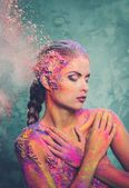Beautiful young woman with conceptual colourful body art  — Stock Photo