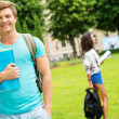 Handsome man student in a city park on summer day  — Stock Photo #48166011