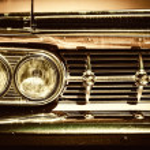 Close-up of retro car facia with chrome grille — Stock Photo