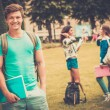 Handsome man student in a city park on summer day — Stock Photo