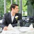 Handsome man in jacket waiting someone in restaurant — Stock Photo #48794795