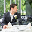 Handsome man in jacket waiting someone in restaurant — Stock Photo