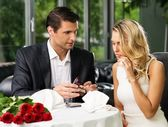 Man holding box with ring making propose to his girlfriend — Stock Photo