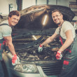 Two mechanics fixing car in a workshop — Stock Photo #49193393