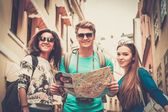 Multi ethnic friends tourists with map in old city  — ストック写真