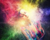 Woman muse with creative body art and hairdo in colourful powder explosion   — Stock Photo