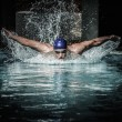 Young man in swimming cap and goggles swim using breaststroke technique  — Stockfoto #49626363