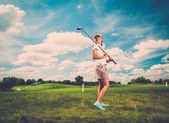 Woman on a golf club field — Stock Photo