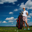 Young cheerful woman with bag and bottle of water on a golf field — Stock Photo #50513905