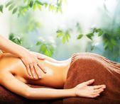 Young woman having massage in a spa salon — Zdjęcie stockowe