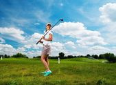 Young beautiful woman on a golf club field  — Stock Photo