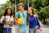 Group of multi ethnic students walking in a city  — Stockfoto