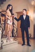 Young couple in luxury home interior — Foto de Stock