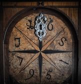 Old wooden door with decoration — Stock Photo