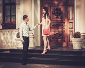 Young couple near luxury home entrance  — Stock Photo