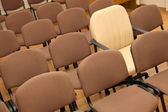 Manager chair among ordinary chairs — Stock Photo