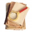 Stack of books and magnifying glass — Stock Photo #1632268