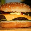 Foto Stock: Cheesburger on foreground