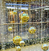 Big gold fir-tree spheres and decorations — Stock Photo