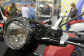 The wheel and the headlight of the motor scooter — Stock Photo