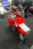 HAMBURG, GERMANY - FEBRUARY 22: The red motorscooter on February 22, 2014 at HMT (Hamburger Motorrad Tage) expo, Hamburg, Germany. HMT is a large motorcycle expo — Stock Photo