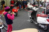 HAMBURG, GERMANY - FEBRUARY 22: The white motorscooter on February 22, 2014 at HMT (Hamburger Motorrad Tage) expo, Hamburg, Germany. HMT is a large motorcycle expo — Stock Photo