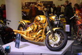 HAMBURG, GERMANY - FEBRUARY 22: The gold motorcycle on February 22, 2014 at HMT (Hamburger Motorrad Tage) expo, Hamburg, Germany. HMT is a large motorcycle expo — Stock Photo