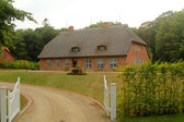 Former German Villa in a thatched roof — Stock Photo