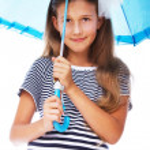 Portrait of beautifu girl posing on white background with umbrel — Stock Photo