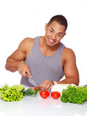 Portrait of muscle man posing in kitchen — Stock Photo