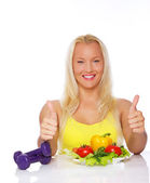 Portrait of vegetarian posing in studio with vegetables — Stock Photo
