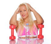 Portrait of sexy woman posing in studio with dumbbells — Stock Photo