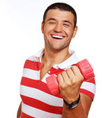 Portrait of muscle man posing in studio with dumbbells — Stock Photo