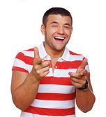 Portrait of handsome man posing in studio in t-shirt — Stock Photo