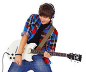 Portrait of young rocker posing in studio on white background — Stock Photo