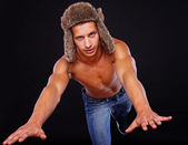 A man in a hat is performing a jump — Stock Photo