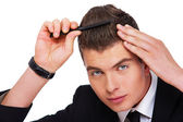 A young man with a comb — Stock Photo