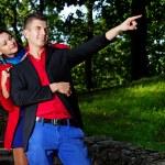 Portrait of couple posing in park — Stock Photo
