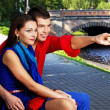 Portrait of couple of lovers posing in city park — Stock Photo
